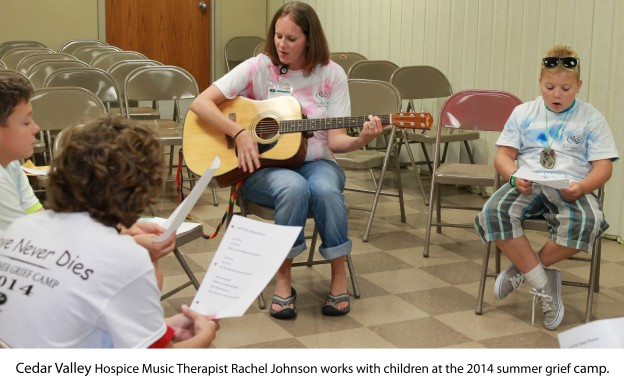 Cedar Valley Hospice Music Therapist Rachel Johnson works with children at the 2014 summer grief camp.