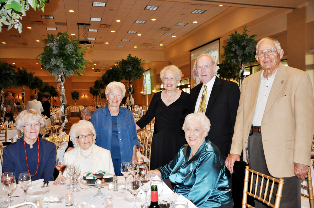 Dorothy Burkhart, second from left, joined longtime friends Kitty Myers and Lorraine Mochal at Cedar Valley Hospice's Diamond and Pearl Gala celebrating the organization's 30th anniversary in 2009. While there, Kitty won an auction bid for a skydiving adventure – one she took to the sky on Sept. 26, 2010. She wore her husband, Dick's orange jumpsuit in honor of him. All three ladies were pioneers in starting Independence's first hospice. Also pictured are Cedar Valley Hospice supporters Cary Nielsen, Pat and Burnell Haven and Wilbur Nielsen.